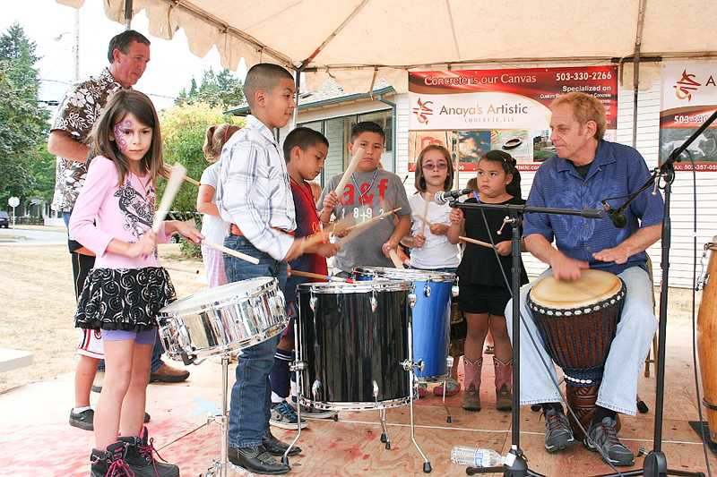 Master drummer Rollo jams with some of the youth attending Summer Fest, which offered music, games, pony rides, emergency vehicles, food, dancing and more.