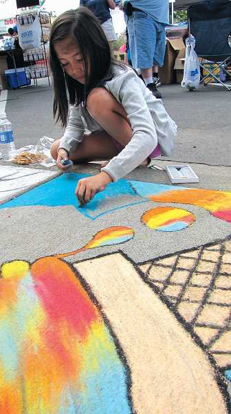 by: HARRY LEE KWAI - This girl was among dozens who took part in creating sidewalk chalk art at Gervais' downtown festival last year. This year's festival will be Saturday from 10 a.m. to 4 p.m.
