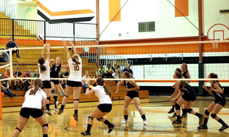 by: CORY MIMMS - Katelin Satyna sends one over Sweet Home's defense.