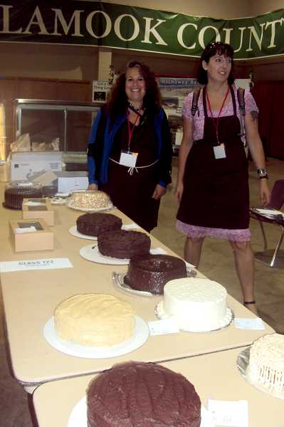 by: SUBMITTED - Marilyn DeVault, owner of Piece of Cake Bakery, left, and Kate Hubbard, a Piece of Cake baker, judged more than 100 entries in cake competitions at the Oregon State Fair.