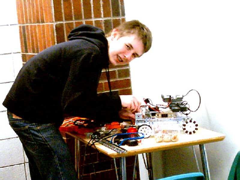 Spencer Roof working on Robot.2.