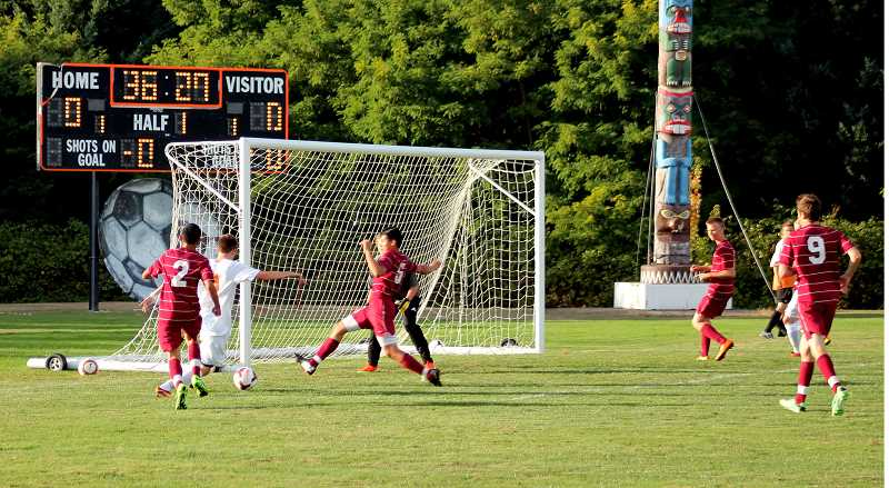 by: CORY MIMMS - Darian Baughman cuts through the Tigers' defense and scores the first goal of the game.