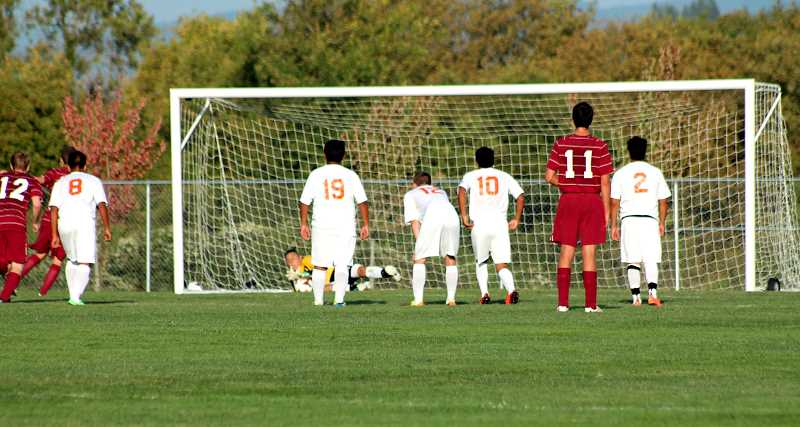 by: CORY MIMMS -  A.J. Escalante makes a diving save on a penalty kick.
