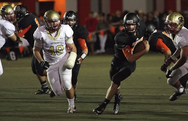 by: TIMES FILE PHOTO - Beaverton wide receiver Bryce Barker had three catches, a touchdown run and a touchdown pass during the Beavers 35-6 win over Century.