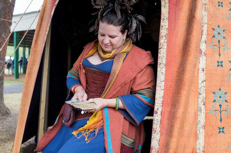 by: PAMPLIN MEDIA GROUP PHOTO: CHASE ALLGOOD - Shannon the Fortune Teller reads tarot cards in a colorful tent.