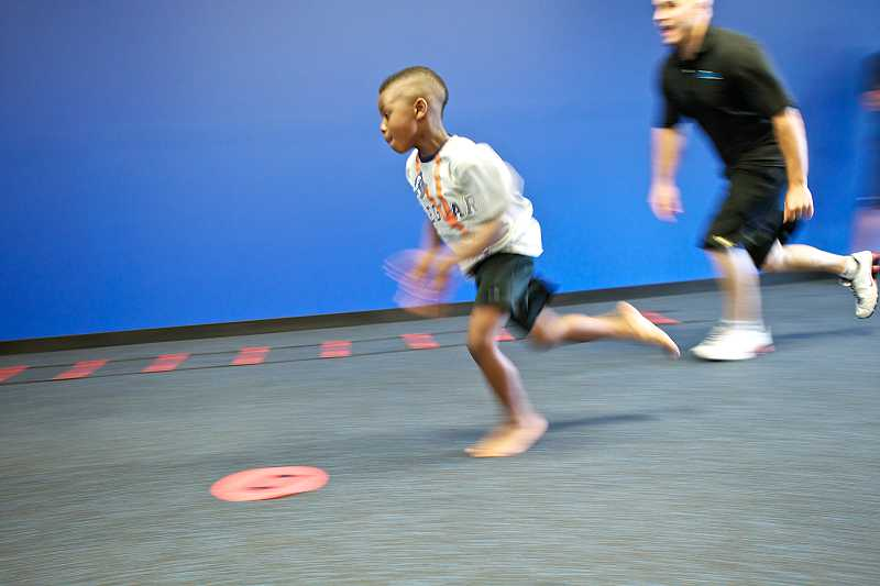 by: TIMES PHOTO: JAIME VALDEZ - Cedric Sloan Jr., 6, sprints during a shuttle run drill at BIO Force Youth Fitness.
