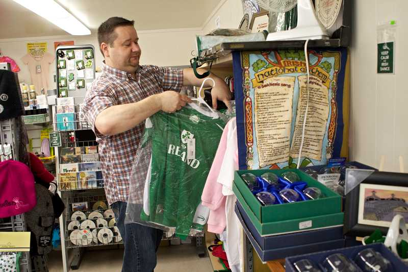 by: TIMES PHOTO: JAIME VALDEZ - Jonathan Sullivan sells Ireland-centric soccer and rugby jerseys at his business, Forget Me Not Ireland, on Beaverton-Hillsdale Highway in Raleigh Hills.