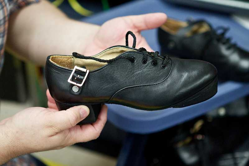 by: TIMES PHOTO: JAIME VALDEZ - Traditional Irish jig shoes are among the merchandise Jonathan and Nicole Sullivan sell at Forget Me Not Ireland in Raleigh Hills.