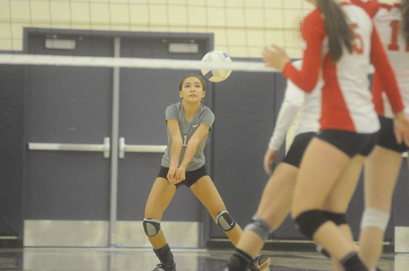 by: MATTHEW SHERMAN - Sophomore Emily Scott returns at libero for the Lakeridge volleyball team this fall. The Pacers return their entire starting lineup this season.
