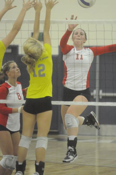 by: MATTHEW SHERMAN - Cassie Jarrell returns at middle blocker for a talented and experienced Lake Oswego volleyball team this year. The team has been hampered by injuries early on, including a twisted ankle for Jarrell.