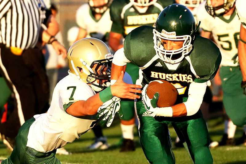 by: JO WHEAT - North Marions Kyle Williamson scored three touchdowns in the first half to keep the Huskies in the game against the Regis Rams.