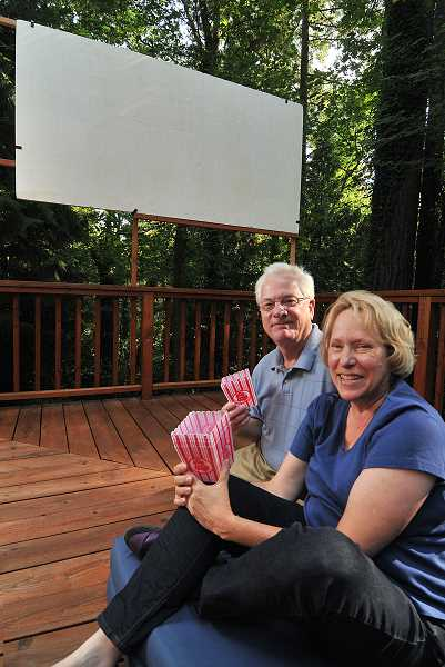 by: REVIEW PHOTO: VERN UYETAKE  - Couple John Lee and Jean Shaw get ready for a night under the stars - and the silver screen.
