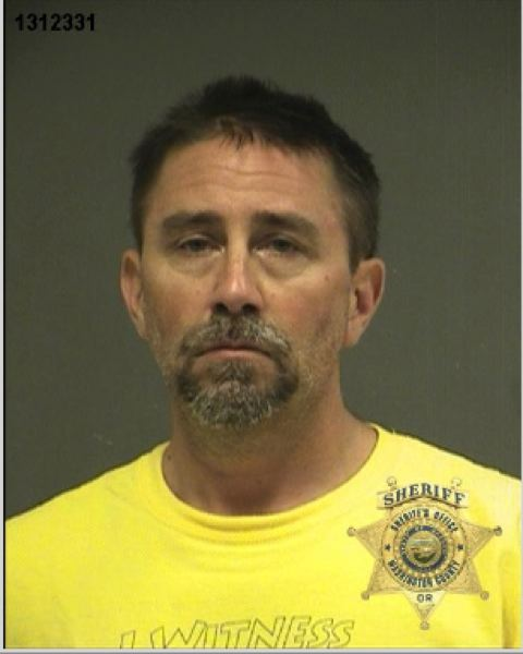 by: WASHINGTON COUNTY SHERIFF'S OFFICE - Joseph Spina, 48, of Portland, was arrested Thursday morning after he allegedy demanded treatment while holiding a gun to his head in the emergency room at Providence St. Vincent Medical Center.