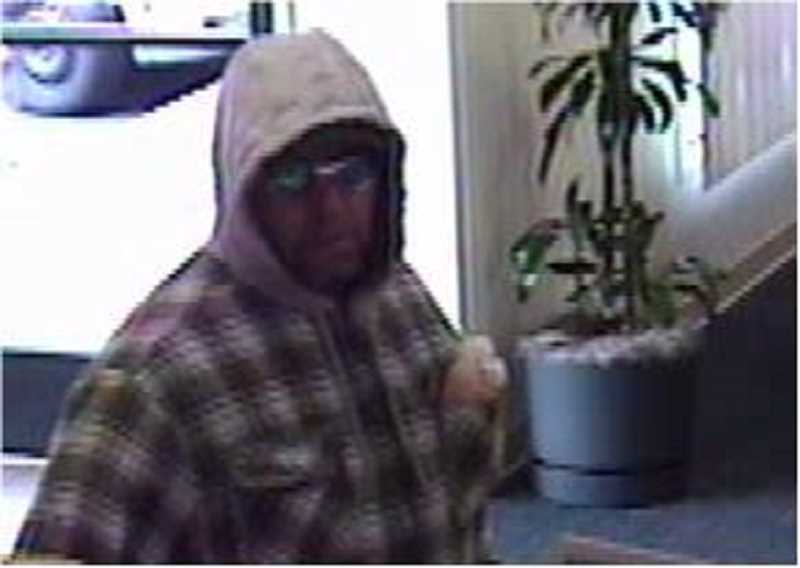 by: SUBMITTED PHOTO - The Tualatin Police Department released this surveillance image of the man believed to have robbed Bank of the West in Tualatin Thursday morning.