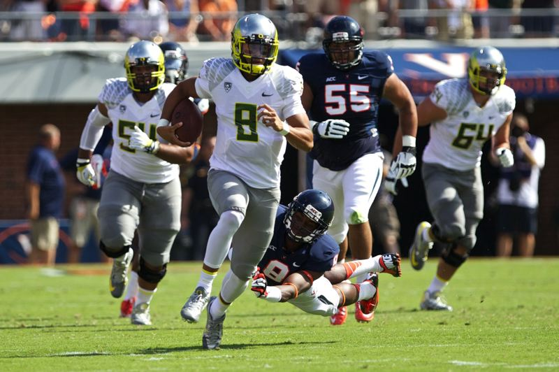 by: TRIBUNE PHOTO: JAIME VALDEZ - Marcus Mariota runs 71 yards for Oregon's first touchdown in Saturday's 59-10 win at Virginia.