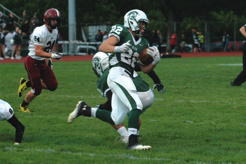 by: PAMPLIN MEDIA GROUP: PARKER LEE - Wilsons Tyler Lunceford gets around the corner during Fridays 14-6 loss to Sandy.