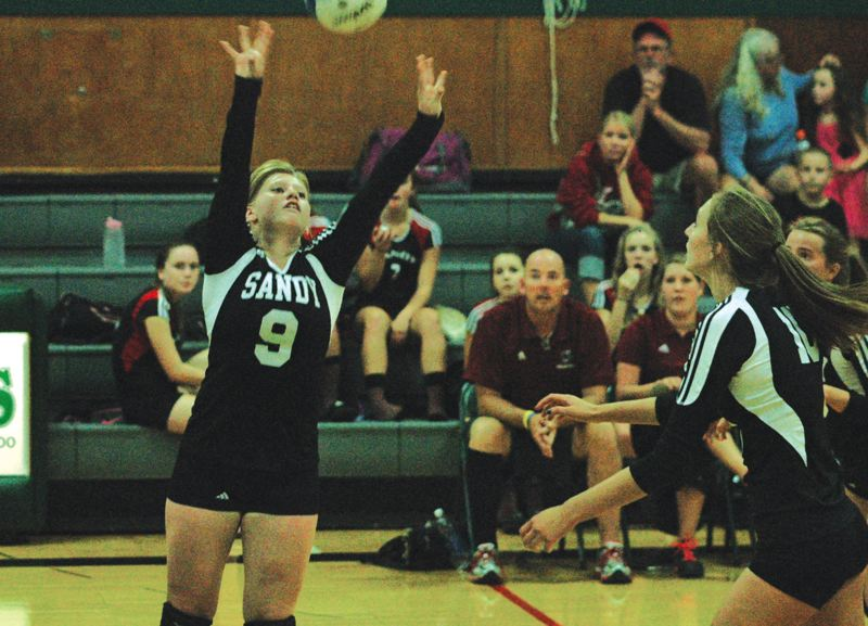 by: SANDY POST: PARKER LEE - Sandys Ashley Laughlin sets a ball toward the outside of the court during last weeks 3-0 loss to Estacada.