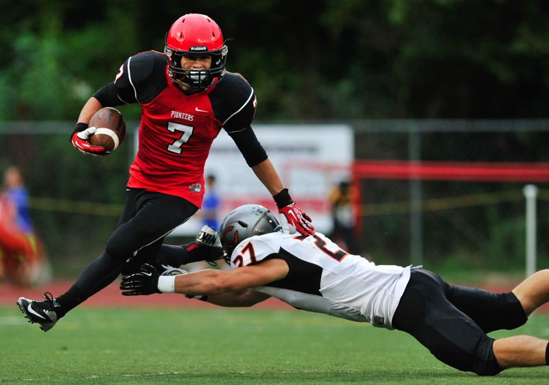 by: JOHN LARIVIERE - Oregon City sophomore running back Conner Mitchell (7) eludes a tackler in last Fridays 42-20 win over Crater. Mitchell had a huge game, rushing 40 times for 311 yards.