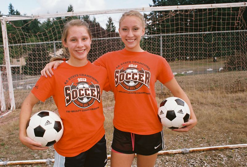 by: JOHN DENNY - Gladstone team co-captains Kelsey Hathaway (left) and Mikaela Simac say they expect Gladstone to still be playing soccer on Nov. 16, the date of the Class 4A state final.
