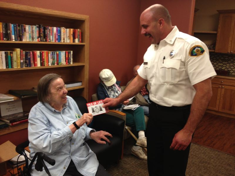 by: PHOTO COURTESY: CLACKAMAS FIRE DISTRICT NO. 1 - Clackamas Fire EMS Officer Bill Conway hands out over 100 File of Life folders to residents of Rose Villa this summer to allow residents to write down all their important medical information and provide the best possible treatment to first responders.