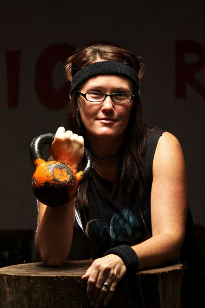 by: PHOTO BY JAIME VALDEZ - Jody Schreffler hefts a kettlebell.