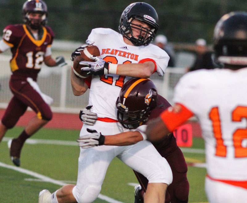 by: TIMES FILE PHOTO - Beaverton senior linebacker Grant Johnson anchors a solid Beaver defense that likes to force turnovers and fly to the football.