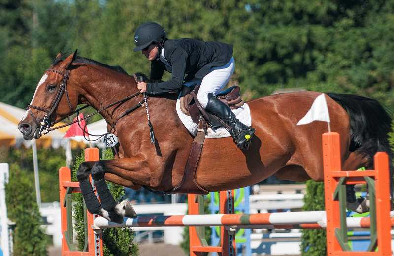 by: JOSH KULLA - Laura Piccard rides Scandalous in the 5-, 6-, 7- and 8-year-old jumper 1.25 meter championships.