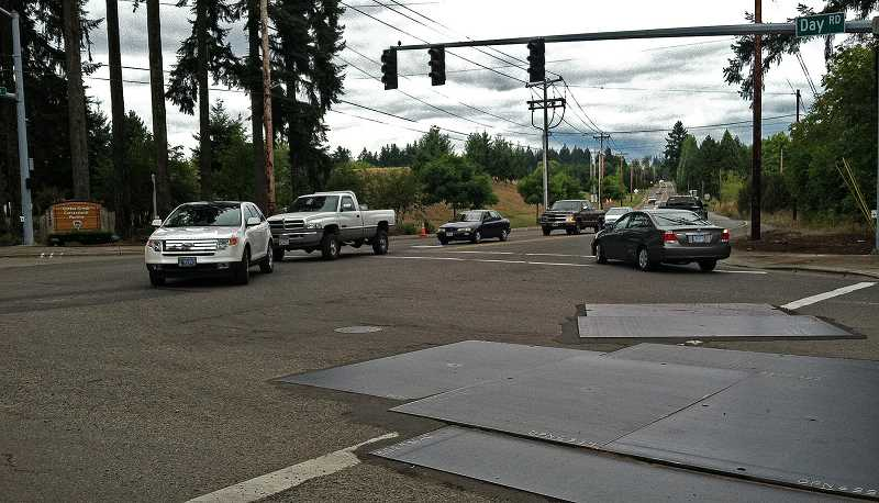 by: JOSH KULLA - City of Wilsonville officials are concerned about the potential impact a proposed Tonquin Road rock quarry might have on Day Road, shown at its intersection with Grahams Ferry Road.