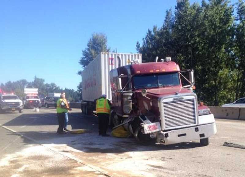 by: OREGON STATE POLICE - Diesel fuel spilled from the semi after the accident Tuesday morning.