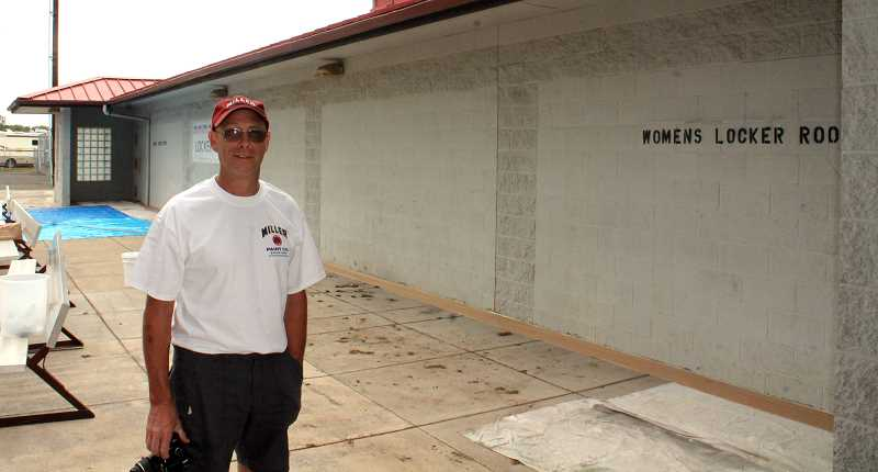 by: CORY MIMMS - Steve Neer at Heckard Field. Behind him, the locker rooms are still painted gray.