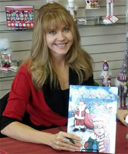 by: SUBMITTED PHOTO - Laura Lee Scotts book The Santa Switch, was named the Best Published Childrens Book.