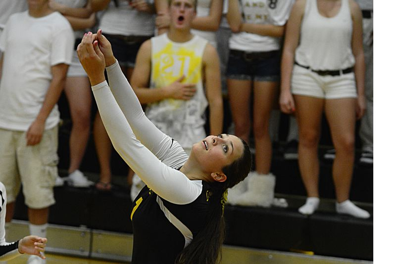 by: JOHN WILLIAM HOWARD - Gabby Susee makes a pass during the third and final set of St. Helens' win over Parkrose. The Lions flattened Parkrose in straight sets.