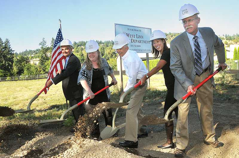 by: TIDINGS PHOTO: VERN UYETAKE - From left, Councilor Thomas Frank, Councilor Jody Carson, Mayor John Kovash, Councilor Jenni Tan and Councilor Mike Jones each drive a shovel into the ground Monday, marking the beginning of construction of a new police station.