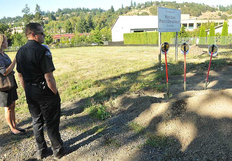 by: TIDINGS PHOTO: VERN UYETAKE - Police Chief Terry Timeus looks over the site of the future police station, where ground was broken Monday.