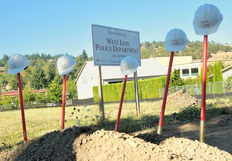 by: TIDINGS PHOTO: VERN UYETAKE - Hard hats and shovels await the city council to break ground for the new police station in West Linn.