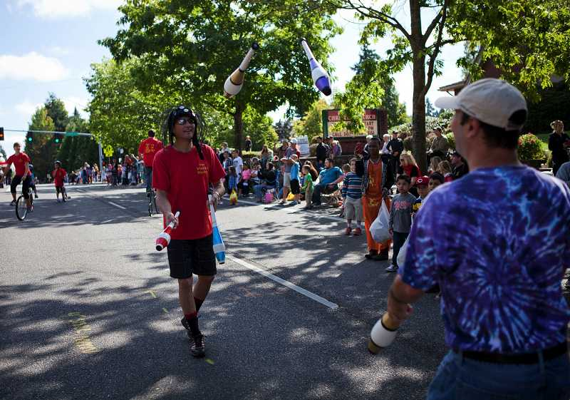 by: TIMES PHOTO: ADAM WICKHAM - Members of One Wheel Wonders unicycling and juggling club dazzle the crowd with their tricks.
