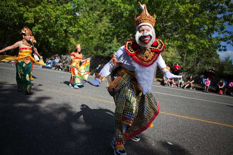 by: TIMES PHOTO: ADAM WICKHAM - Representatives from the Indonesian Community of Oregon add a bit of culture to the parade with their colorful attire.