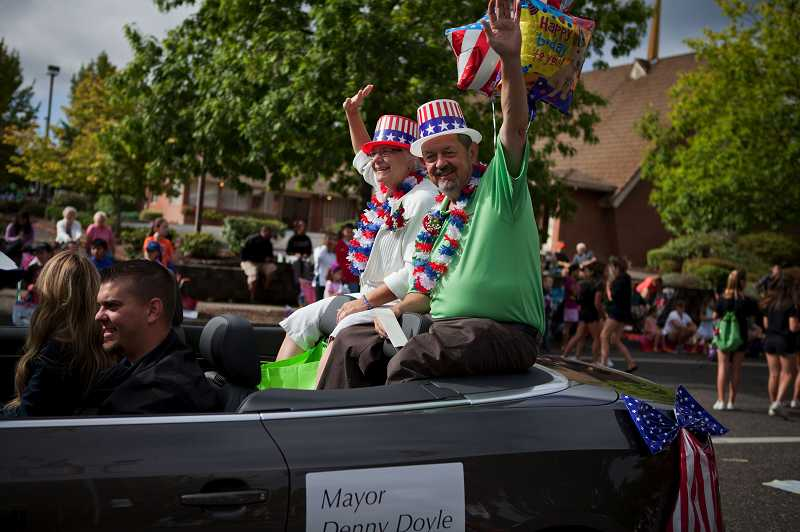 by: TIMES PHOTO: ADAM WICKHAM - Beaverton Mayor Denny Dole and his wife Ann wave to the crowd as they make their way along the parade route.