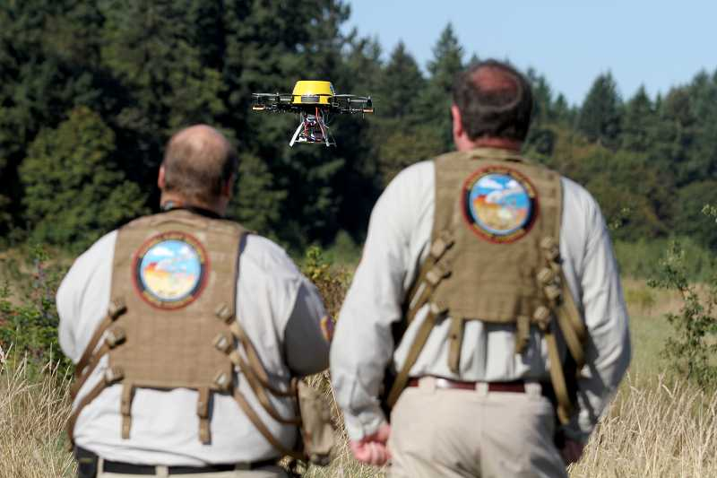 by: TIMES PHOTO: JONATHAN HOUSE - Brian Zvaigzne and Patrick Sherman have used the drone they built to aid first responders and perform scientific research.
