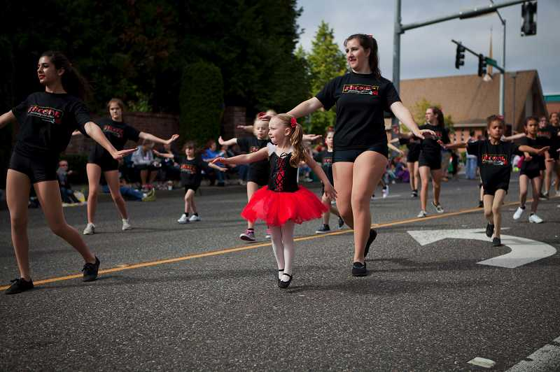 by: TIMES PHOTO: ADAM WICKHAM - Dancers from Encore Performing Arts Center returned for another year as parade participants.