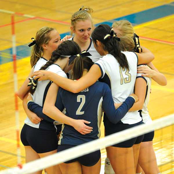 by: NEWS-TIMES PHOTO: ZACK PALMER - Banks volleyball players, including sophomore Megan Bunn (center), huddle before a match at last year's Class 4A state tournament at Lane Community College in Eugene.