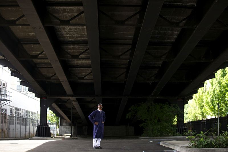 by: TRIBUNE PHOTO: JAIME VALDEZ - Ibrahim Mubarak, co-founder of the Right 2 Dream Too Old Town camp, stands under the Broadway Bridge where the homeless group plans to move as part of a city deal negotiated during the past few weeks.