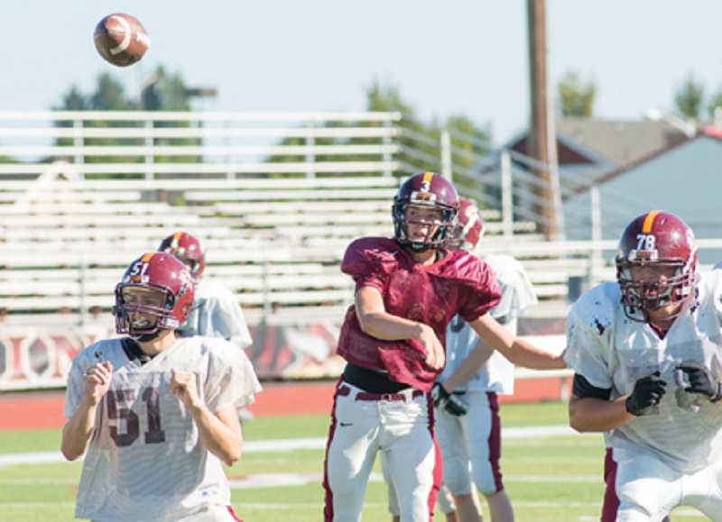 by: NEWS-TIMES PHOTO: CHASE ALLGOOD - Forest Grove sophomore quarterback Taylor Jensen throws a pass during practice on Monday. Jensen has led the Vikings to their first 2-0 start since 2010.