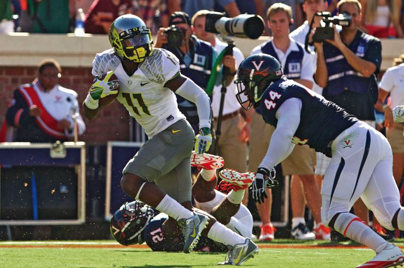 by: TRIBUNE PHOTO: JAIME VALDEZ - UO receiver Bralon Addison beats the Virginia defense down the sideline for a touchdown in the Ducks 59-10 road victory last week.