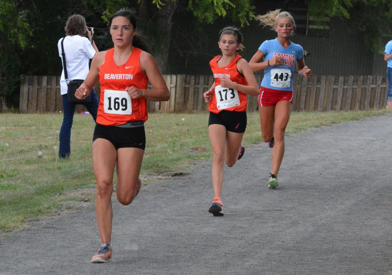 by: TIMES PHOTO: MATT SINGLEDECKER - Beavertons Emma Bowers, front, and Olivia Rabin, back, went six-seven for the Beavers at the Tualatin Invite last Wednesday.