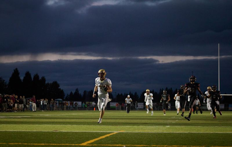 by: TIMES PHOTO: ADAM WICKHAM - Southridge running back Jacob Pruit cruises to the house for a touchdown against Tualatin.