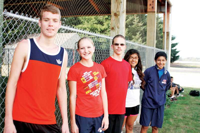 by: PHIL HAWKINS - Kennedy High School and its cross country team were represented at the Portland to Coast race in August. From left, John Savage, Lauren Stokley, Brent Lang, Cheyla Moranchel and Noe Jines were five members of a 12-person team.