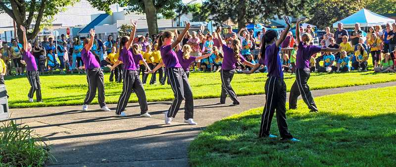 by: RAY HUGHEY - The Allegro Dance Studio dancers perform at the Kiss Summer Goodbye celebration.
