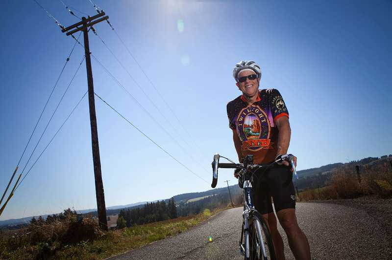by: PHOTO FOR THE TIMES: ADAM WICKHAM - Ray Hennings of Aloha takes a short break during his daily bike training on Riedweg Road in the hills around Cornelius on Monday afternoon. Hennings will fly to South Carolina for a three-day, 220-mile bike trek to highlight kidney disease awareness.