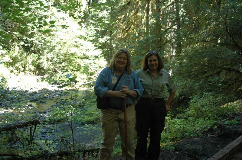 by: ISABEL GAUTSCHI - Teri Gaarsland, left, operations manager of  Mt. Hood Recreation and Kathleen Walker, west side recreation program manager for the Mt. Hood National Forest pose on the trail on the way to Bagby Hot Springs.